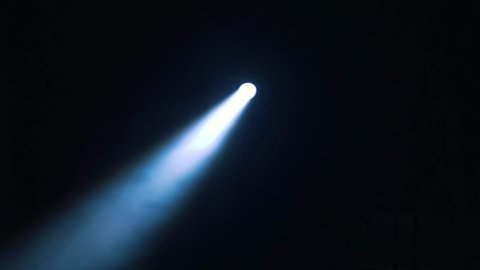 Flashlight beam moving into total darkness. Ray of light pointing to multiple spots finding its way.