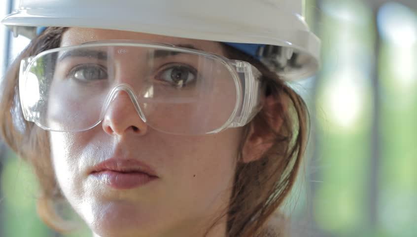 Female construction worker smiling | Shutterstock HD Video #1012617608