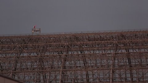 Mountainview, California / USA - February 4, 2013: Rotating light flashes on top of the skeleton remains of a Zeppelin Hangar