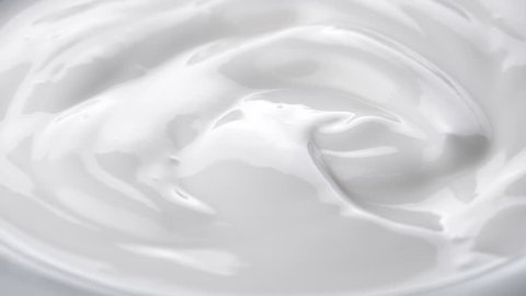 Closeup shot of mixing yogurt Rotating