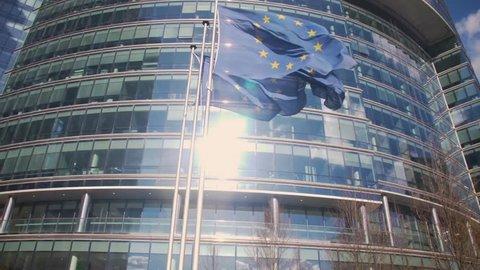 European Union building with waving European Flags