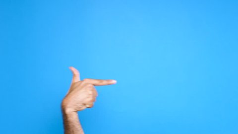 Male hand over a blue background pointing at something. Close up footage of hand only