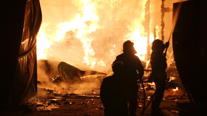 Firefighters Battling A Fire Closeup Slow Motion 4K   Shutterstock HD Video #1012708058