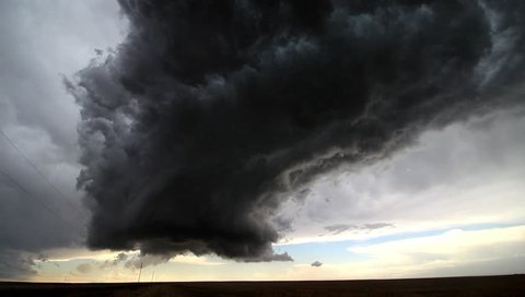 Time lapse footage of a supercell thunderstorm towering over the Great Plains.