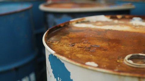 Old rusty barrels from oil products