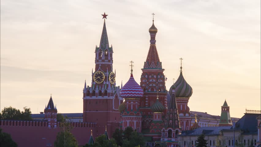 Moscow Saint Basil's Cathedral and Kremlin Spasskaya Tower sunset