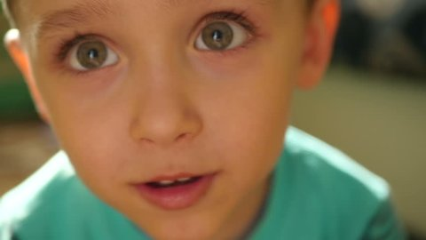 Close-up: the eyes and nose of the child at a slowed pace. The boy enjoys close-up