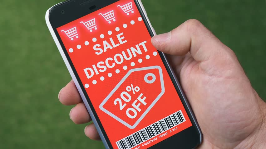 Swiping trough many discount coupons to save money on a smartphone device.