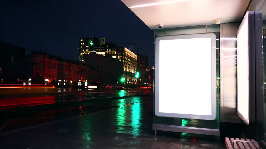 Night bus station with billboard. White blank screen. | Shutterstock HD Video #1012841678