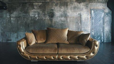 modern golden leather sofa in loft on background