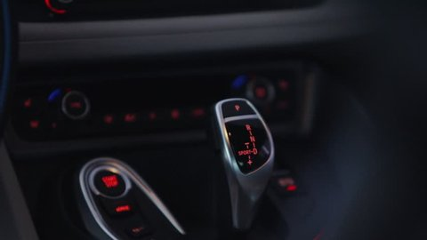 Modern car interior, view of the car's gearbox knob