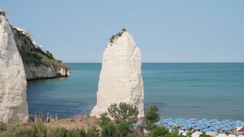 Beach of Pizzomunno famous white rock, in Vieste, Gargano coast, Puglia, Italy.