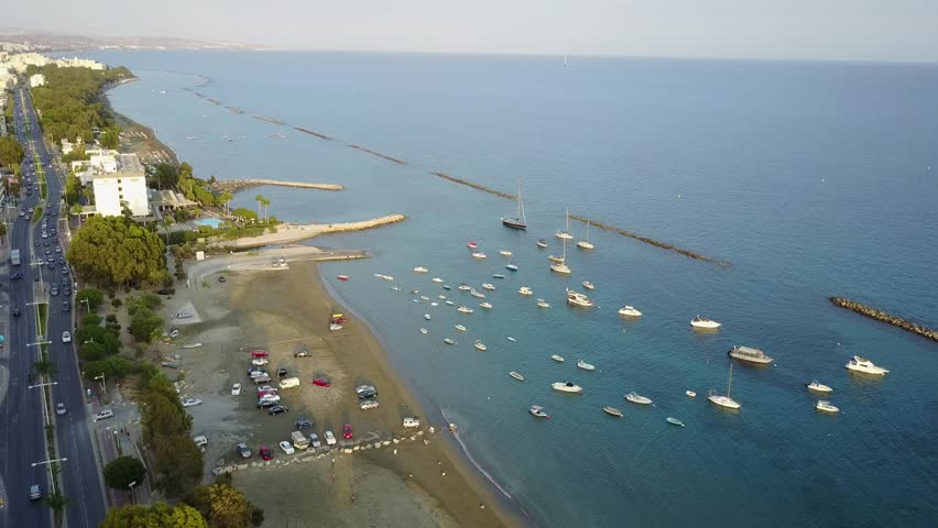 Aerial rotating shot from water view to inland Limassol, Cyprus