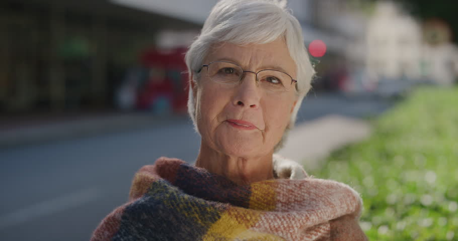 Portrait of happy elderly woman laughing cheerful enjoying successful retirement lifestyle on sunny urban day in city street wearing scarf confident retired caucasian female | Shutterstock HD Video #1012992398