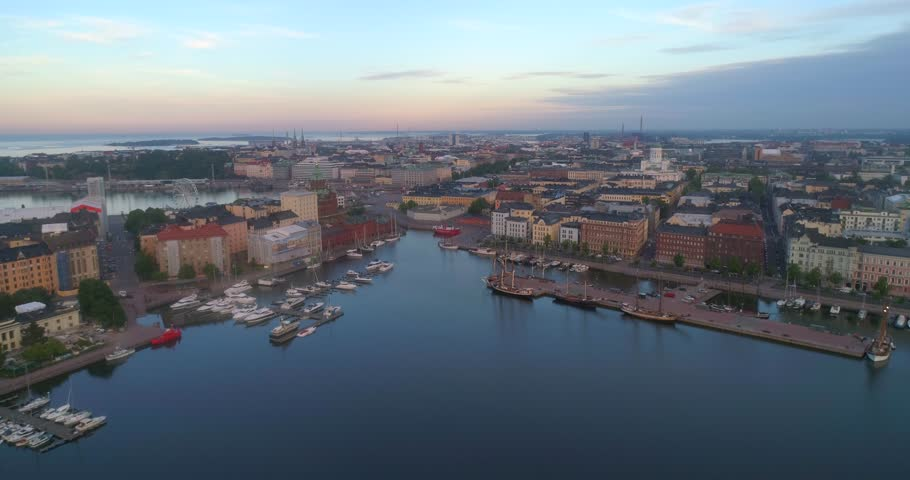 The coast of Helsinki, C4k aerial rising view revealing the cityscape and churches of Helsingfors, on a sunny summer morning dawn, in Helsinki, Uusimaa, Finland | Shutterstock HD Video #1013062388