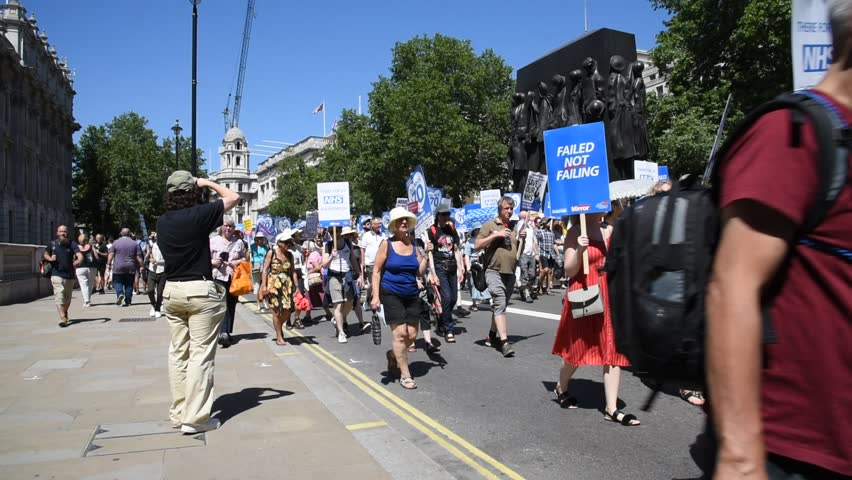 London, UK June 30, 2018 Thousands of people take part in a  march to mark the 70th anniversary of the NHS and to defend it from  dismantling and privatization