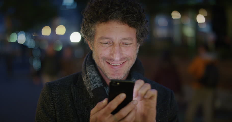 Portrait of handsome mature man using smartphone | Shutterstock HD Video #1013089118