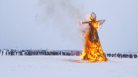 Pancake week - pagan Slavic holiday with the burning of stuffed winter. Maslenitsa in Russia, Kaluga.