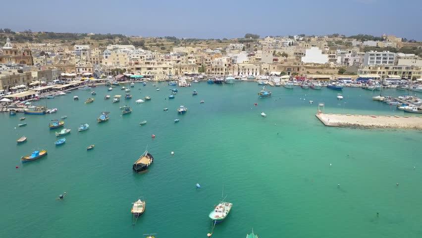 beautiful drone footage of the small fishing village in Malta, Marsaxlokk