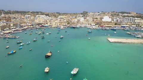 beautiful drone footage of the small fishing village in Malta, Marsaxlokk