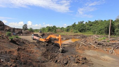 KUCHING, MALAYSIA - MAY 25 2015: Deforestation. HD Video of tropical rainforest in Borneo being destroyed to make way for oil palm plantation.