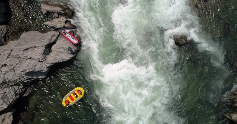 Aerial top down shot as raft enters the whitewater on the Yoshino River in Tokushima Japan 60fps for slow motion