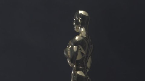 MONTREAL, CANADA - June 2018 : Golden oscar looking trophy closeup rotating