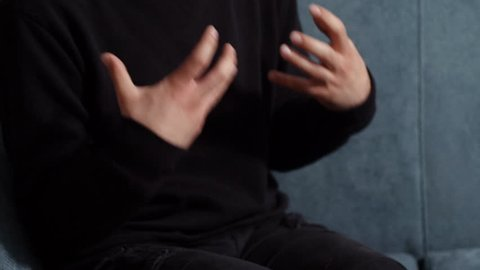 Therapy session: close up on nervous, anxious man's hands