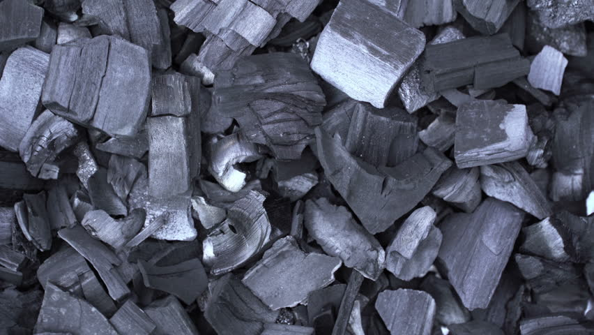 Black charcoal rotation texture background. 4k seamless loop video