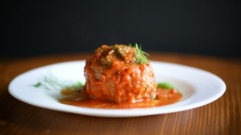 meatballs with tomato sauce on the table