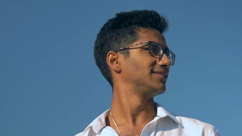 Close-Up, Slow Motion, Beautiful Indian Man in Glasses and White Shirt Looks at the Party and Smiles | Shutterstock HD Video #1013318498