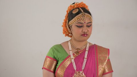 Indian girl showing different moods using traditional Bharat Natyam dance form. Angry expression.