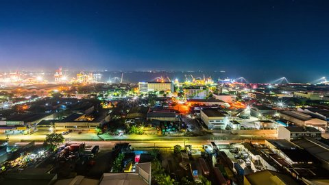 Cebu City, Philippines - June 6, 2018: Cebu City Timelapse view showing view over port of Cebu with ships loading at night