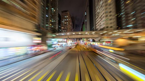 Wan Chai, Hong Kong - June 30, 2018: Wan Chai Timelapse view showing view from a tram moving through Wan Chai and Happy Valley at night