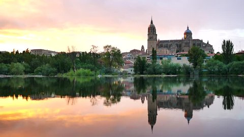 Tormes River in Salamanca with the New Cathedral reflection on water surface , 4k time lapse at sunset
