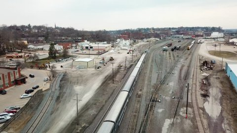 BURLINGTON, IOWA - CIRCA 2017 - Aerial of the Southwest Chief Amtrak train traveling through a railroad yard near Burlington, Iowa.