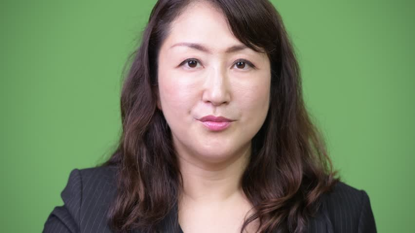 Mature beautiful Asian businesswoman looking shocked | Shutterstock HD Video #1013379488