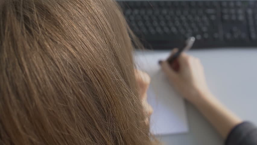 Female office manager talking on phone, doing notes on paper about sales order | Shutterstock HD Video #1013421548