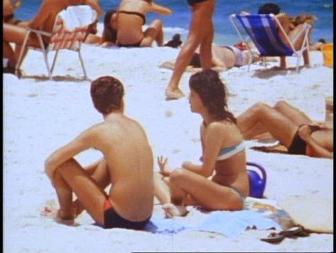 BRAZIL, 1982, Rio de Janeiro, Copacabana beach, couple on beach seated