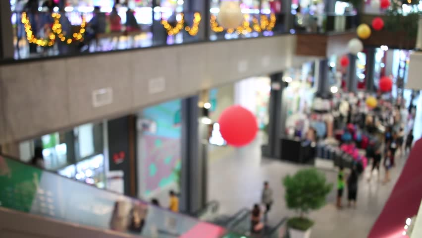 Blurred of People walking shopping in department store center at modern building Defocused blur background.