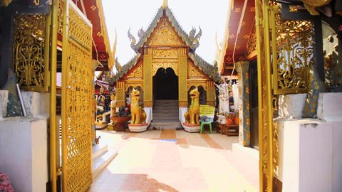 Wat Phra That Doi Kham a Buddhist temple in the historic of Chiang Mai, Thailand with Slow Motion Fly Shot, Steady Cam Shot, in Thailand.