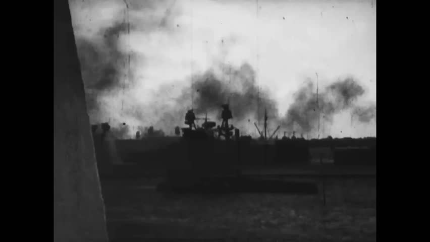 CIRCA 1941 - The USS Arizona bursts into flames in Pearl Harbor.