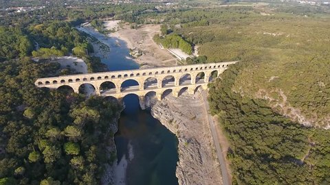 Aerial drone shot of a bridge le Pont du Gard in South of France. Sunset time