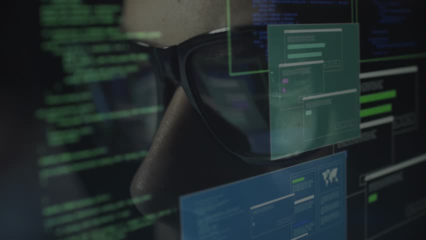 Young nerd hacker with glasses connecting online and stealing data, cyber crime and hacking concept | Shutterstock HD Video #1013580518
