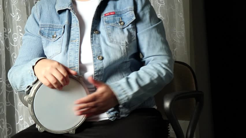 GIRL PLAYING THE DARBUKA