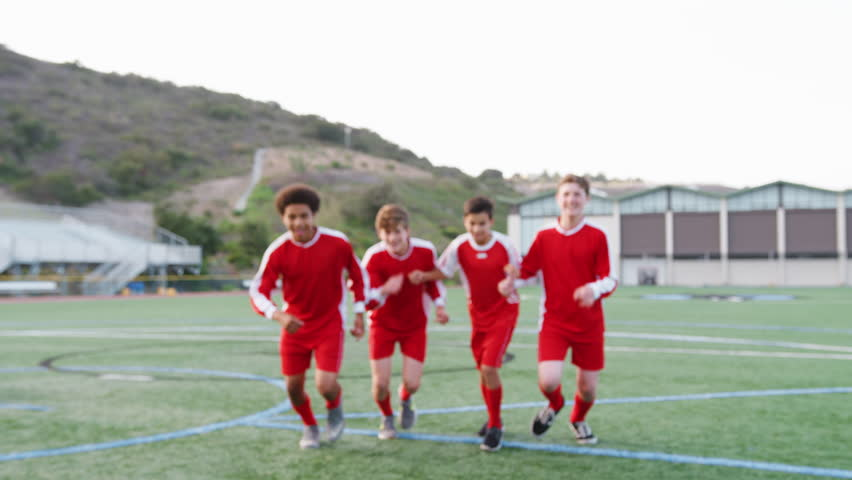 Portrait Of Male High School Soccer Team Running Towards Camera And Celebrating   Shutterstock HD Video #1013598668