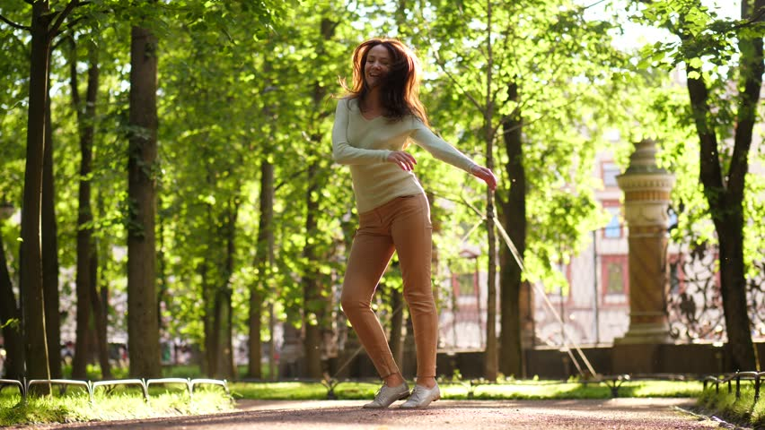 Woman dancing twist and jump in park. Dancer girl jump and laugh outside. | Shutterstock HD Video #1013614238