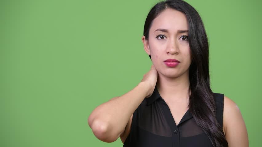 Young beautiful Asian businesswoman having neck pain | Shutterstock HD Video #1013619428