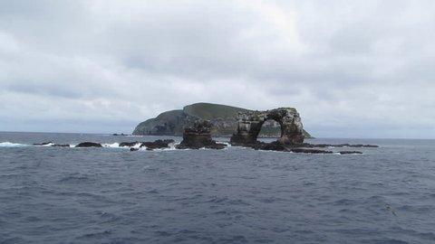 Wide of Darwin's Arch with Darwin Island behind in the Galapagos Islands.