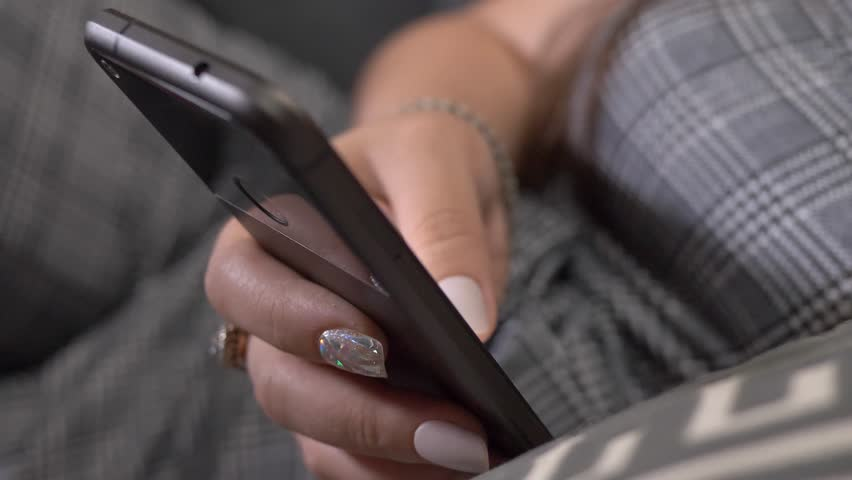 Smartphone being used by a woman in her hands | Shutterstock HD Video #1013640068